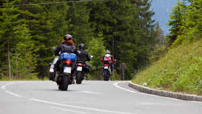 3 motorcyclists back